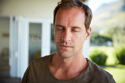 Buy stock photo Cropped shot of a man spending the day at home