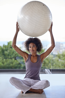 Buy stock photo Full-length portrait of an attractive young woman holding up an exercise ball