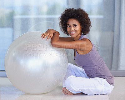 Buy stock photo Full-length portrait of an attractive young woman sitting with an exercise ball