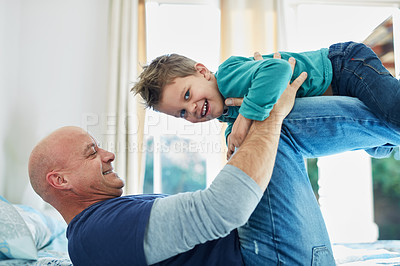 Buy stock photo Cropped shot of a father and son bonding together at home