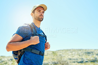 Buy stock photo Cropped shot of a young man out on a hike