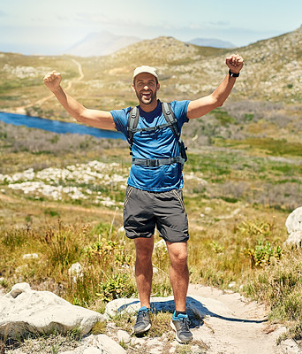 Buy stock photo Portrait of a young man celebrating while out on a hike