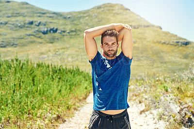 Buy stock photo Portrait of a young man warming up before a run