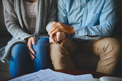 Buy stock photo Closeup shot of a couple holding hands in comfort