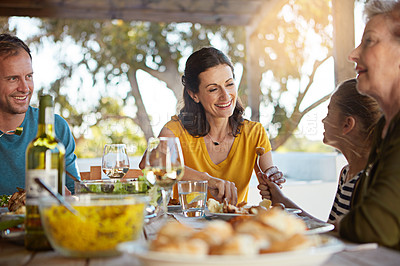 Buy stock photo Cropped shot of a family enjoying a meal together at home