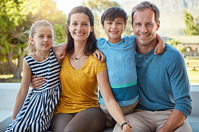 Buy stock photo Shot of a family of four spending time together in their backyard
