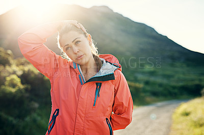 Buy stock photo Shot of an athletic young woman out for a run on a cool morning