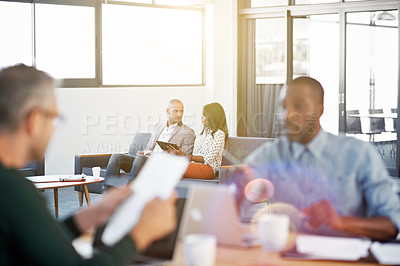 Buy stock photo Shot of individual businesspeople working in an open plan office