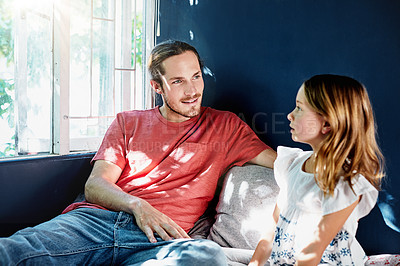 Buy stock photo Shot of a handsome young man talking to his daughter at home