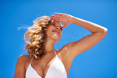 Buy stock photo Shot of an attractive young woman enjoying a vacation at the beach