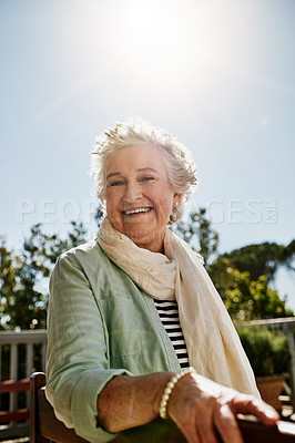 Buy stock photo Portrait of a happy senior woman relaxing outdoors