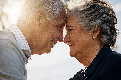 Buy stock photo Shot of a happy senior couple spending time together outdoors