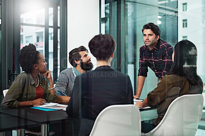 Buy stock photo Shot of a businessman giving a presentation to his colleagues in an office