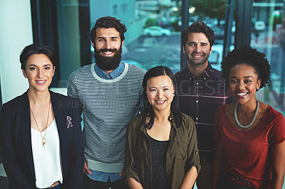 Buy stock photo Portrait of a group of diverse designers standing together in an office