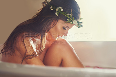 Buy stock photo Shot of a beautiful nude woman  relaxing in a bathtub at home