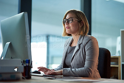 Buy stock photo Cropped shot of a businesswoman working late at night in her office