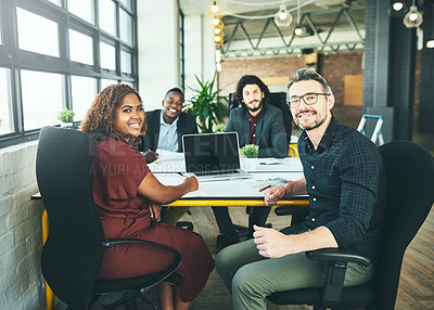 Buy stock photo Cropped portrait of a group of colleagues working around a desk in their office