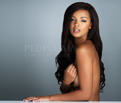 Buy stock photo Shot of a beautiful young woman posing topless against a grey background