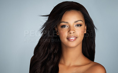 Buy stock photo Studio portrait of a beautiful young woman with flawless skin posing against a gray background