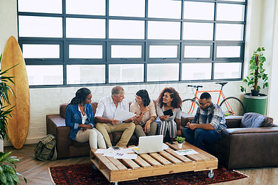 Buy stock photo Shot of a group of colleagues collaborating in a modern office