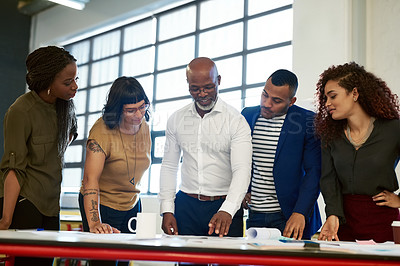 Buy stock photo Shot of a group of creative businesspeople working together on a project