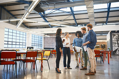 Buy stock photo Full length shot of a group of designers talking while standing around in their office