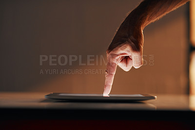 Buy stock photo Cropped shot of an unrecognizable person using a digital tablet
