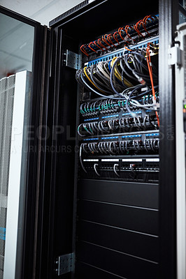 Buy stock photo Cropped shot of the inside of a computer with all of it's wiring located in a server room