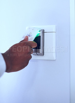 Buy stock photo Unrecognizable shot of a hand using a access card on a scanner to let the person gain access and open a door