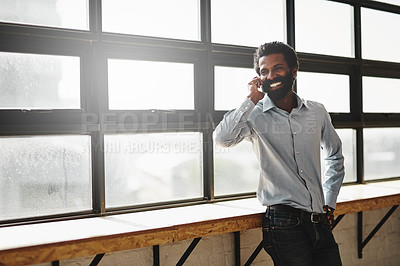 Buy stock photo Shot of a businessman talking on a cellphone in an office