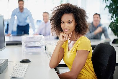 Buy stock photo Portrait of an attractive young businesswoman sitting in an office with her colleagues in the background