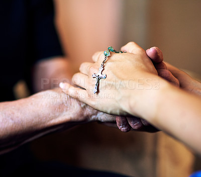Buy stock photo Cropped shot of a senior woman being comforted by her nurse while holding a rosary