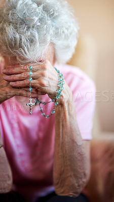 Buy stock photo Cropped shot of a senior woman holding a rosary while praying for a miracle