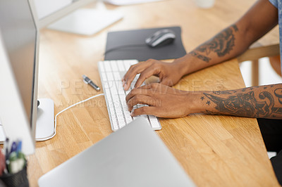 Buy stock photo Shot of an unrecognisable designer working on a computer in an office