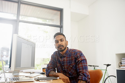 Buy stock photo Portrait of a young designer sitting at his desk in the office