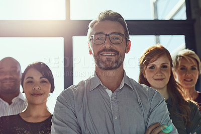 Buy stock photo Cropped shot of a group of business colleagues standing in the office with confidence and looking at the camera