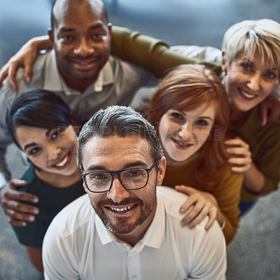 Buy stock photo High angle portrait of a team of colleagues standing together in a modern office