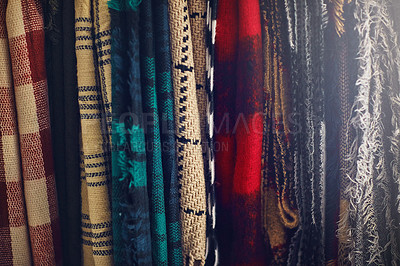 Buy stock photo Closeup shot of scarfs hanging in a store