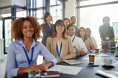 Buy stock photo Cropped portrait of a group of businesspeople sitting in the boardroom during a presentation