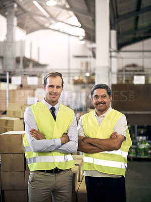 Buy stock photo Portrait of two colleagues standing together in a factory