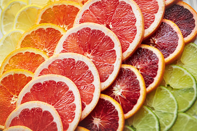 Buy stock photo Shot of a variety of citrus fruits cut into slices