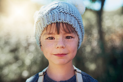 Buy stock photo Portrait of an adorable little boy playing outside