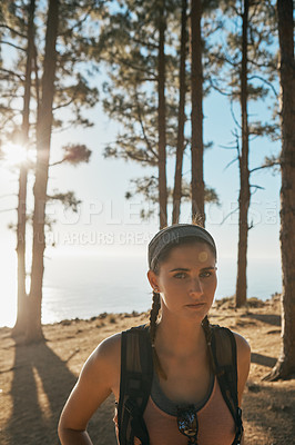 Buy stock photo Portrait of a young woman out on a hike in the forest