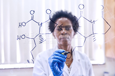 Buy stock photo Shot of a female scientist drawing molecular structures on a glass wall in a lab