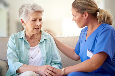 Buy stock photo Shot of a caregiver consoling a senior patient in a nursing home