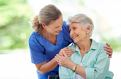 Buy stock photo Shot of a female nurse caring for a senior patient in a retirement home