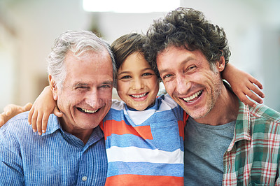 Buy stock photo Shot of a little boy with his father and grandfather