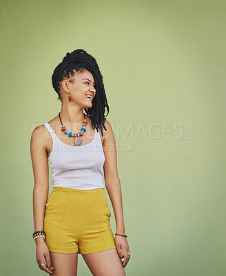 Buy stock photo Shot of an attractive and trendy young woman posing against a green background