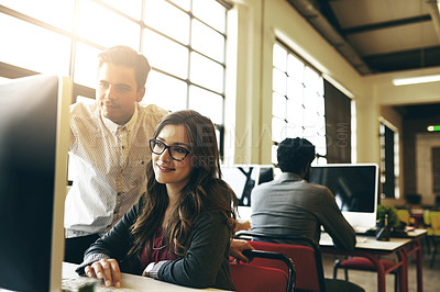 Buy stock photo Cropped shot of a young businessman helping a female colleague in their office