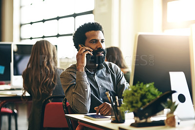 Buy stock photo Cropped shot of a handsome young woman making a phonecall while sitting in his office